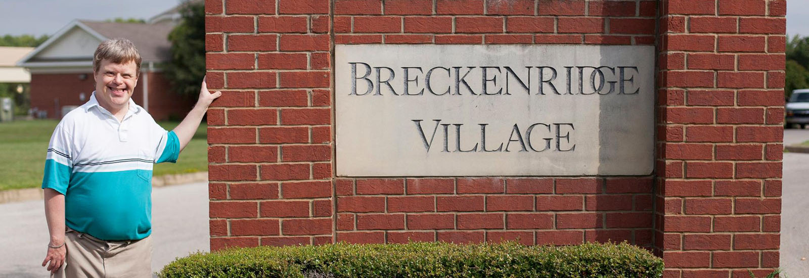 Photo: Jimmy Breckenridge poses with Breckenridge Village sign