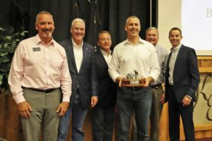 Photo: Award presentation at the Men's Breakfast event