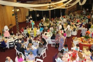 Photo: People eating at Ladies Luncheon Event