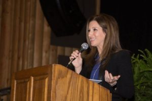 Photo: Woman speaking at Ladies Luncheon Event