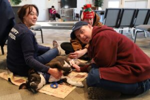Residents enjoying a visit from Therapet